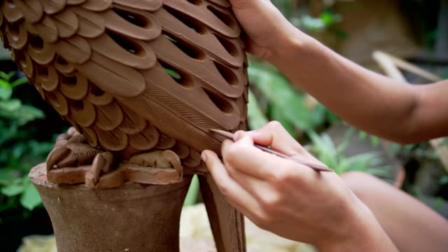 cu : man working on clay sculpture in art class - sculpture stock videos & royalty-free footage