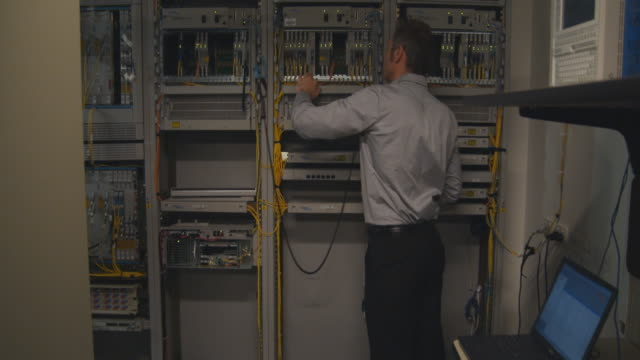 MS Man working on computer server, Sydney, Australia