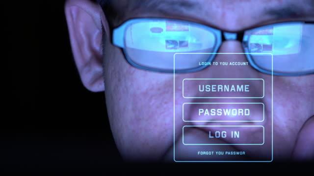 vídeos de stock e filmes b-roll de man working on computer with futuristic screen - feito pelo homem