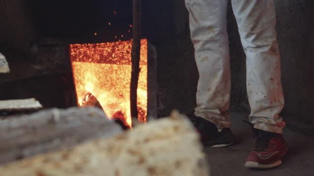man working on distillery still fireplace. mezcal family homemade production - distillery still stock videos & royalty-free footage