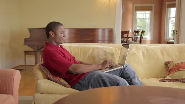 ms pan man working on laptop / portland, oregon, united states  - portland oregon homes stock videos & royalty-free footage