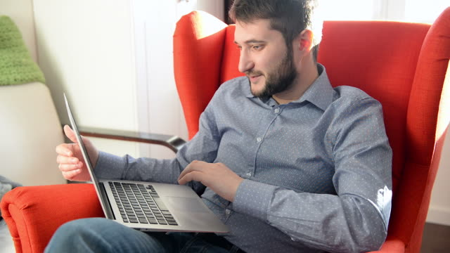 man working on laptop - one mid adult man only stock videos & royalty-free footage