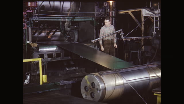 vídeos de stock e filmes b-roll de ms man working on metal sheet machinery in factory / united states - só um homem de idade mediana