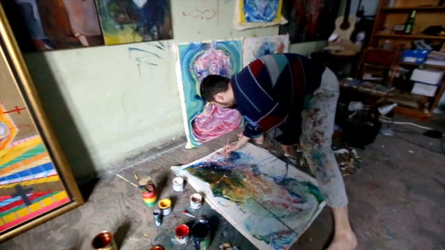 man working on painting in studio - atelier tent stock videos and b-roll footage