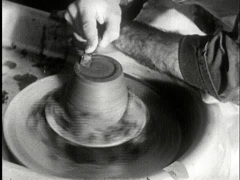 vídeos y material grabado en eventos de stock de cu, b/w, man working on pottery wheel, usa - prelinger archive