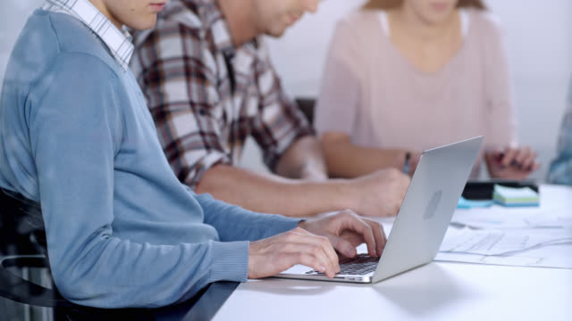 Man working on the laptop while in meeting