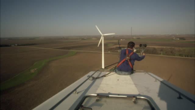 MS Man working on top of wind turbine/ Buffalo Ridge, Minnesota