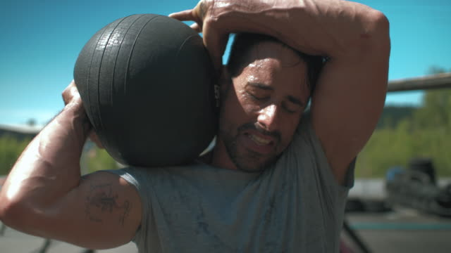 Man Working Out at Outdoor Gym