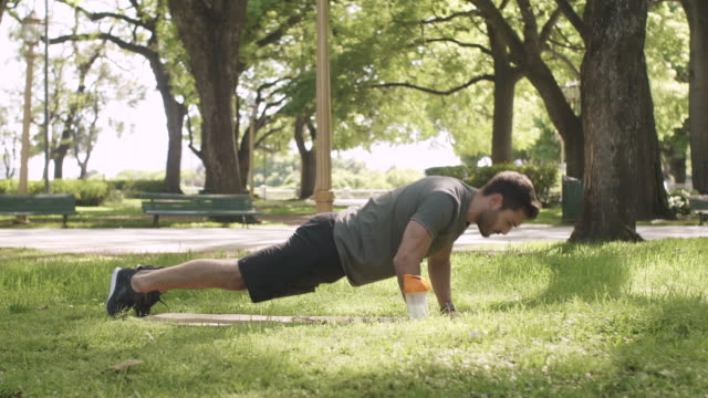 man working out in park - protein drink stock videos & royalty-free footage