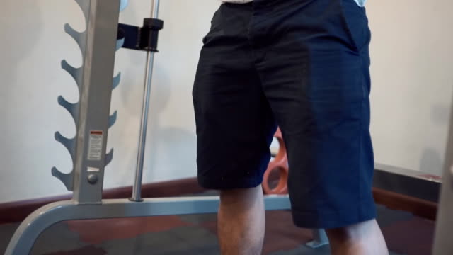 Man Working Out in the Gym , slowmotion