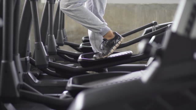 man working out on leg cycle machine in the gym