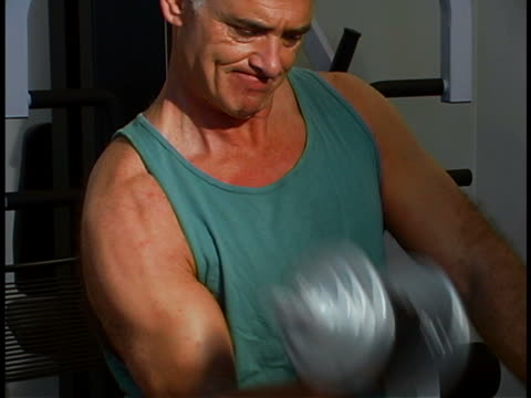man working out - arm curl stock videos & royalty-free footage