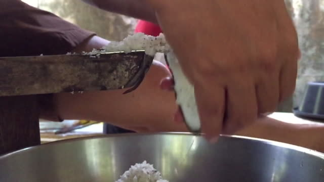 man working to scrape coconut - grater utensil stock videos & royalty-free footage
