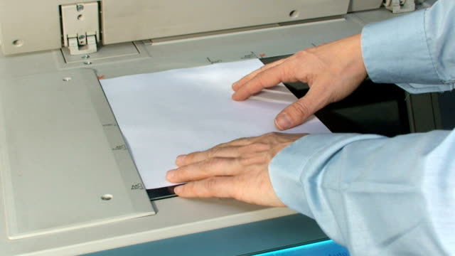 man working with photocopier machine - flyer leaflet stock videos and b-roll footage