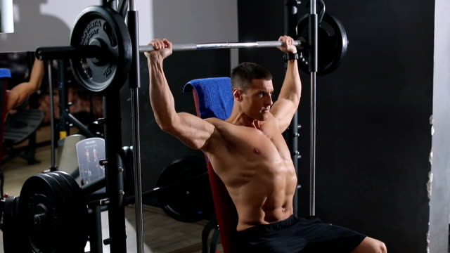 Man Working With Weights In Gym