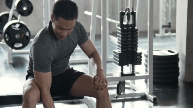 man working with weights lifting in gym - flexing muscles stock videos & royalty-free footage