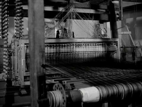 a man works at a weaving loom at the royal college of arts - loom stock videos & royalty-free footage