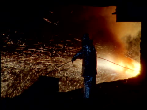 Man works at spewing furnace in Katowice Steel Works