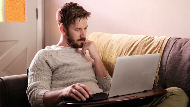 a man works from his couch - tripod - beard stock videos & royalty-free footage