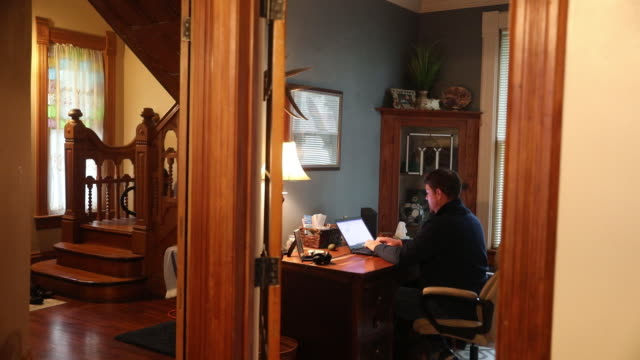 man works on laptop at desk at home amid coronavirus pandemic in princeton, il, u.s. on friday, september 11, 2020. - using laptop stock videos & royalty-free footage