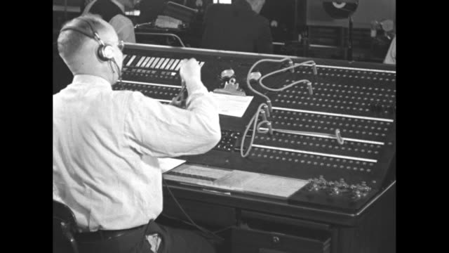 man works telegraph switchboard in us war department / cu telegraph switchboard - telegraph machine stock videos & royalty-free footage