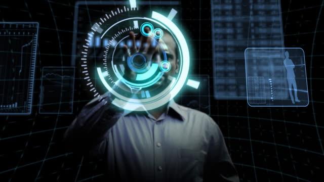 man works with futuristic screen. - kommunikationssätt bildbanksvideor och videomaterial från bakom kulisserna