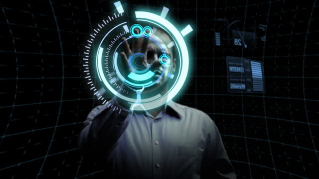 Man works with futuristic screen.