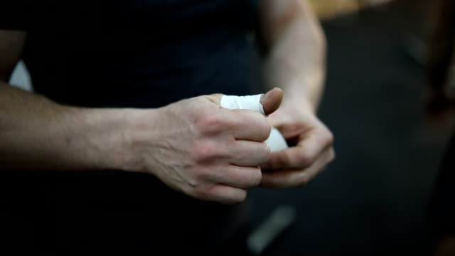 man wrapping fingers with bandage - bandage stock videos & royalty-free footage