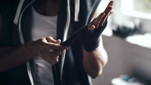 man wrapping hands before workout - bandage stock videos & royalty-free footage
