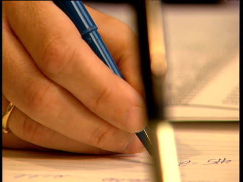 man writes numbers on paper - pen stock videos & royalty-free footage