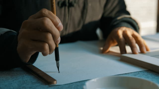 man writing calligraphy - giapponese video stock e b–roll