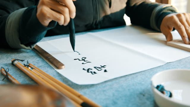 man writing calligraphy - chinese script stock videos & royalty-free footage