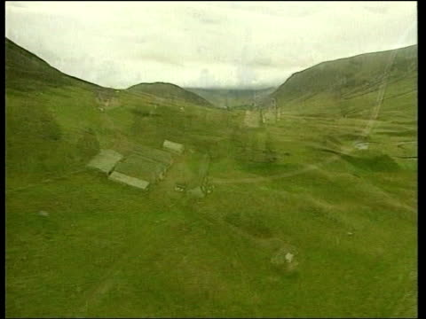 management of scottish countryside; itn scotland: air views green hills air view remote farm buildings int cms dewar interview sot - this is about... - reform stock-videos und b-roll-filmmaterial