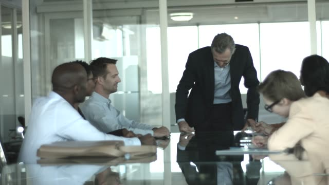 manager discussing with team in board room - 40 49 years stock videos & royalty-free footage