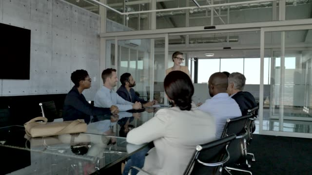 manager explaining business team in board room - office stock videos & royalty-free footage