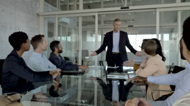 manager explaining team during meeting in office - males stock videos & royalty-free footage