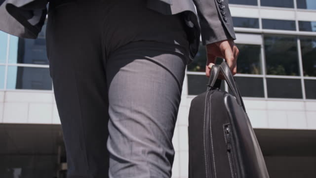 manager going to work - briefcase stock videos & royalty-free footage