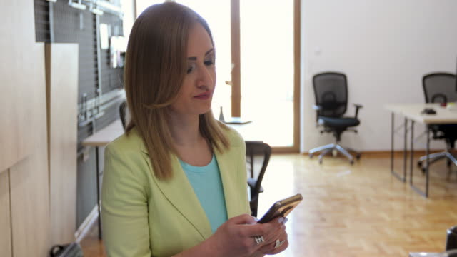 manager having a business talk using smart phone in office - business talk stock videos & royalty-free footage
