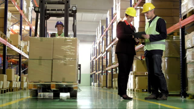 manager signing a document in the warehouse - satisfaction stock videos & royalty-free footage