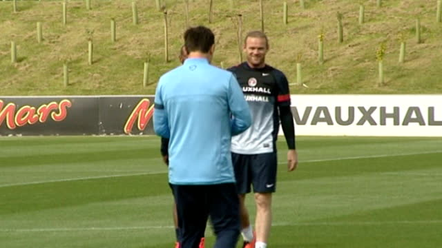 managers critical of extended transfer window 1382013 / t13081336 ext wayne rooney at england football training session - transfer stock videos and b-roll footage