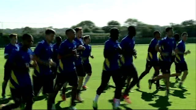 managers critical of extended transfer window ext various of arsene wnger watching arsenal team training at football training session arsene wenger... - transfer stock videos and b-roll footage