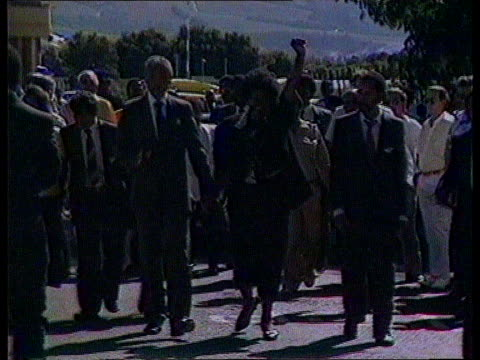 managers return after training itn lib ext ms nelson and winnie mandela towards after his release from prison itn lib south africa johannesburg ls... - releasing stock videos and b-roll footage