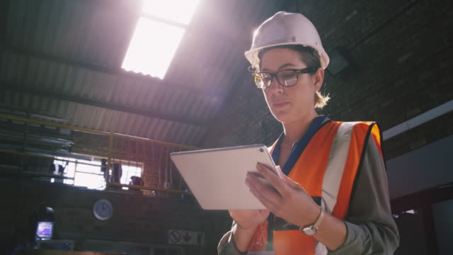 managing site demands with digital tech - using digital tablet stock videos & royalty-free footage
