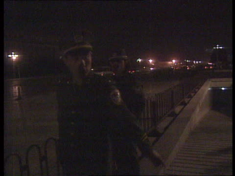vidéos et rushes de china beijing camera in car lms soldiers on dimly lit streets as along track rl ms soldiers guarding entrance to tiananmen square as blocked off from... - place tien an men