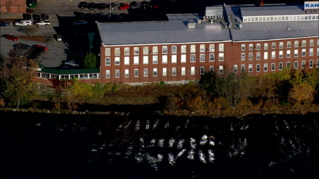 manchester and cotton mills  - aerial view - new hampshire,  hillsborough county,  united states - manchester stock videos and b-roll footage