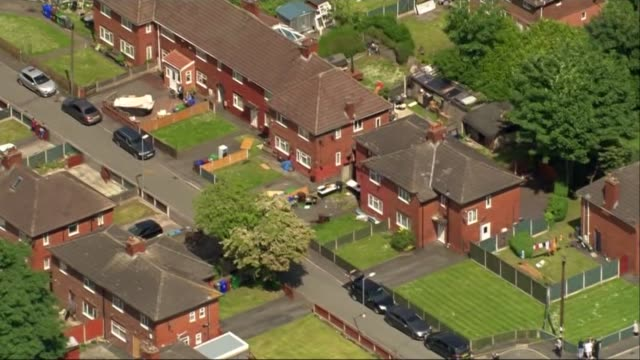 Aerials ENGLAND Manchester Fallowfield EXT **Quality as incoming** over Manchester suburb of Fallowfield showing police forensics officers searching...