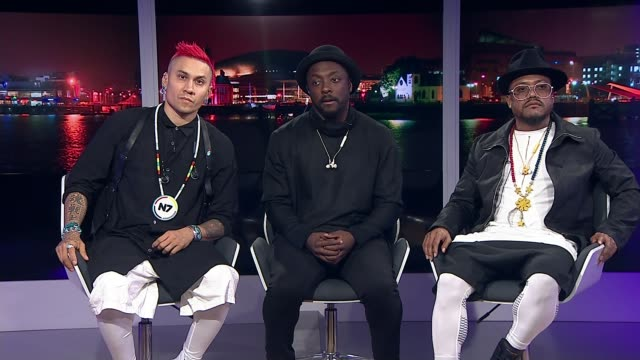 black eyed peas to take part in benefit concert england london gir int william apple and taboo 2way interview from manchester sot - black eyed peas stock videos & royalty-free footage