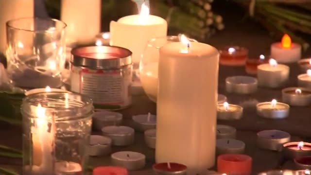 manchester arena attack: candles and floral tributes; england: manchester: ext / night gvs candles and floral tributes for victims of manchester... - manchester arena stock videos & royalty-free footage