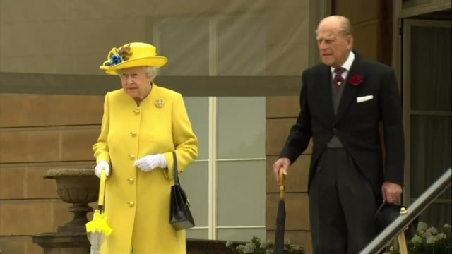 manchester arena attack: election campaign suspended / international reactions; england: london: buckingham palace: ext queen elizabeth ii and prince... - duke of edinburgh stock videos & royalty-free footage