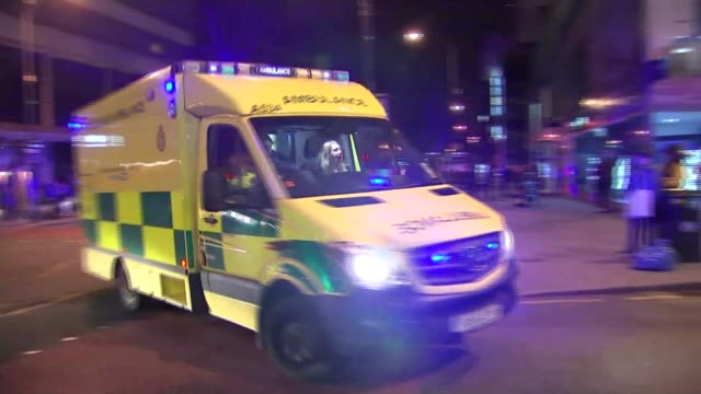 manchester arena attack ext / night ambulances along with flashing lights police vehicles annd cordoned off road ambulance and other emergency... - manchester arena stock videos & royalty-free footage